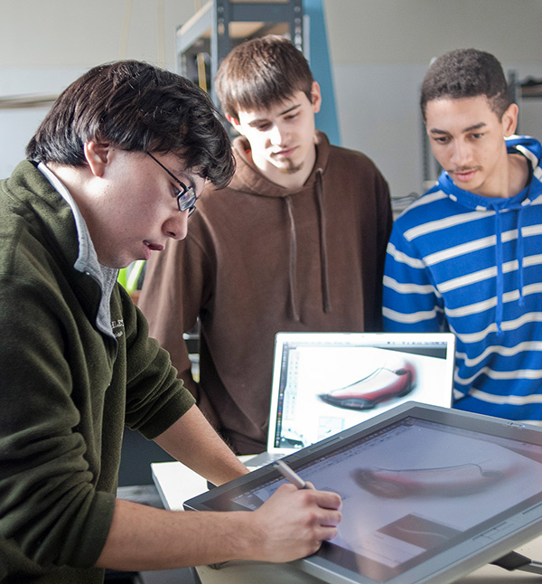 Industrial Design students working on a Cintiq tablet.