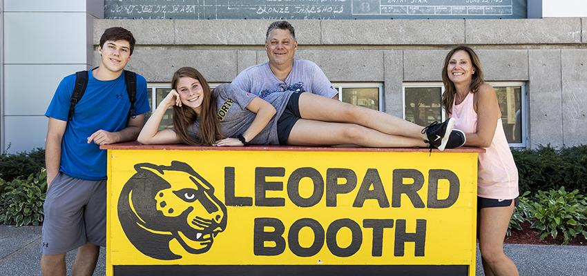 Family posing for a photo at the Leopard Booth
