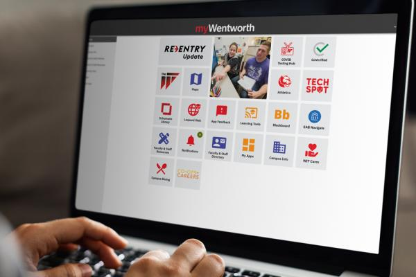 A closeup of hands on a laptop featuring the myWentworth website.