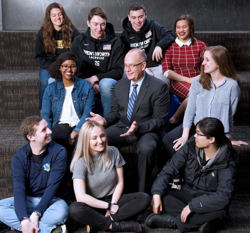 President Thompson sitting surrounded by Wentworth students.