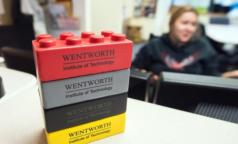 A stack of lego building blocks, branded with Wentworth's logo.