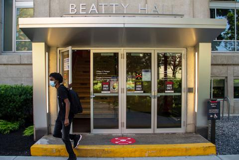 Male student wearing mask leaves Beatty Hall.